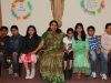 Class II teacher Mrs Jija Varghese with her students
